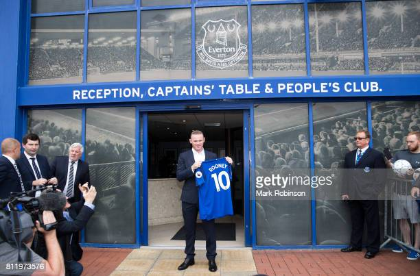 Wayne Rooney holds up his new Everton shirt at Goodison Park on July 10 2017 in Liverpool England