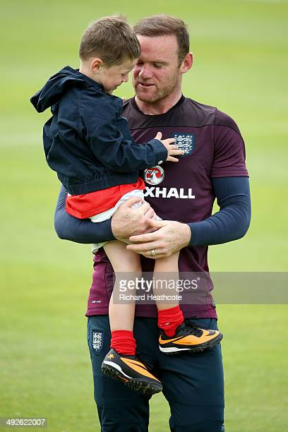Wayne Rooney hugs his son Kai at the end of a training session at the England preWorld Cup Training Camp at the Vale Do Lobo Resort on May 21 2014 in...