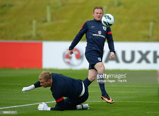 Wayne Rooney in action with Joe Hart during the England Training Session at St Georges Park on May 27, 2013 in Burton-upon-Trent, England.