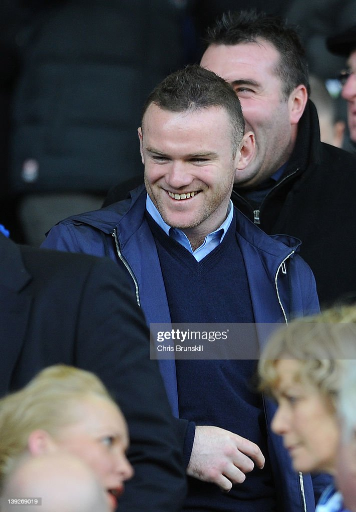 Wayne Rooney in the stands during the FA Cup Fifth Round match between Everton and Blackpool at Goodison Park on February 18, 2012 in Liverpool, England.