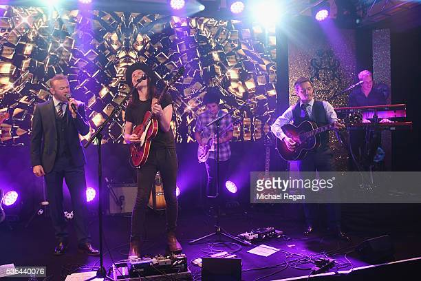 Wayne Rooney James Bay and Gary Neville perform on stage during the England Footballers Foundation charity event at Sopwell House on May 29 2016 in...