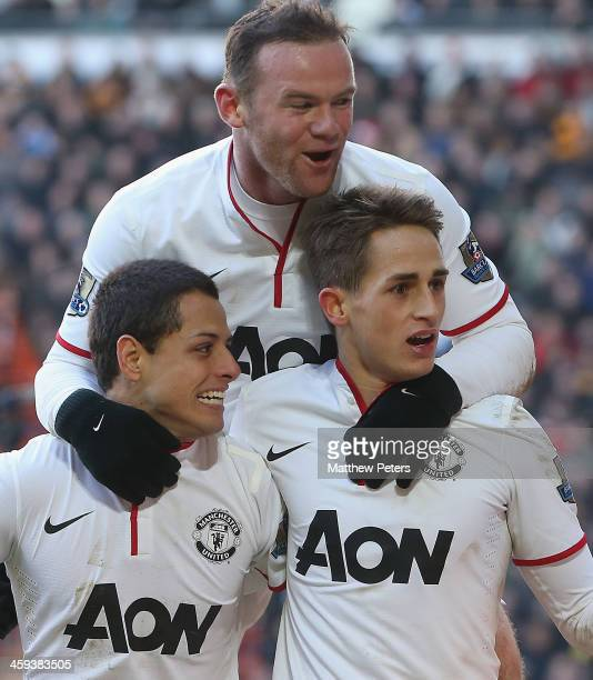 "Wayne Rooney; Javier ""Chicharito"" Hernandez and Adnan Januzaj of Manchester United celebrate James Chester of Hull City scoring an own goal during..."