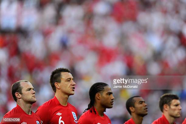 Wayne Rooney, John Terry, Glen Johnson, Ashley Cole and James Milner of England line up for the national anthems during the 2010 FIFA World Cup South...
