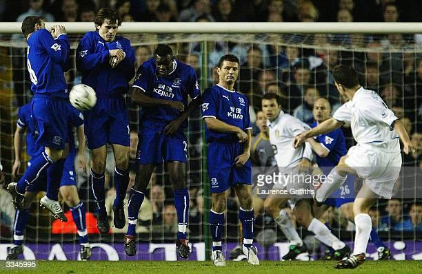 Wayne Rooney Kevin Kilblane Alex Nyarko and Tomasz Radzinski of Everton defend a free kick from Ian Harte of Leeds during the FA Barclaycard...