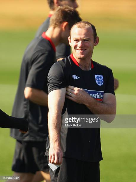 Wayne Rooney laughs at an England training session during the FIFA 2010 World Cup at the Royal Bafokeng Sports Campus on June 24 2010 in Rustenburg...