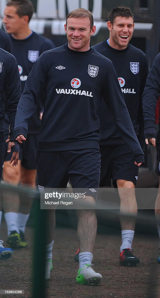 Wayne Rooney laughs during the England training session ahead of their FIFA World Cup qualifier against San Marino at London Colney on October 11, 2012 in St Albans, England.