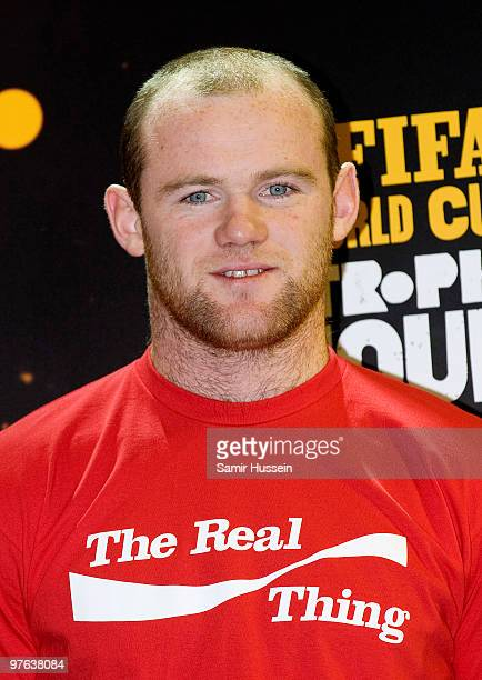 Wayne Rooney looks on after posing with the authentic FIFA World Cup Trophy as part of the FIFA World Cup Trophy Tour on March 11 2010 at Earls Court...