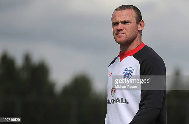 Wayne Rooney looks on during the England training session at London Colney on August 9 2011 in St Albans England