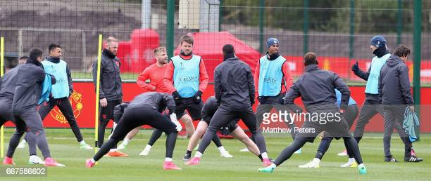 Wayne Rooney Luke Shaw Michael Carrick Marcus Rashford and Zlatan Ibrahimovic of Manchester United in action during a first team training session at...