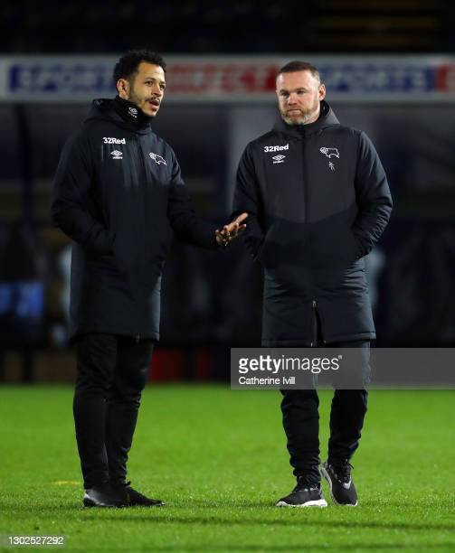 Wayne Rooney manager Derby County with assistant manger Liam Rosenior prior to the Sky Bet Championship match between Wycombe Wanderers and Derby...