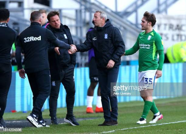 Wayne Rooney, Manager of Derby County interacts with Lee Bowyer, Manager of Birmingham City after the Sky Bet Championship match between Derby County...