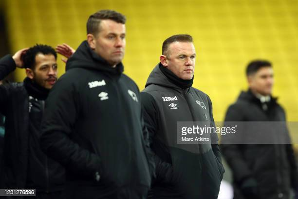 Wayne Rooney manager of Derby County with assistants Liam Rosenior and Shay Given during the Sky Bet Championship match between Watford and Derby...