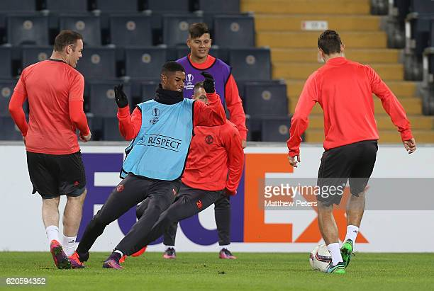 Wayne Rooney Marcus Rashford and Marcos Rojo of Manchester United in action during a first team training session at Sukru Saracoglu Stadium on...