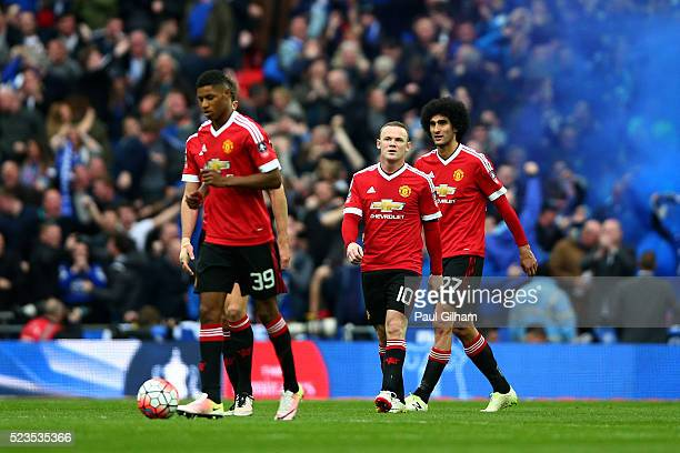 Wayne Rooney Marouane Fellaini and Marcus Rashford of Manchester United look dejected following Chris Smalling of Manchester United's own goal during...