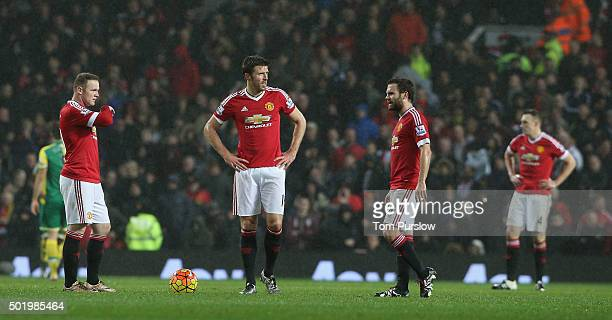 Wayne Rooney Michael Carrick Juan Mata and Phil Jones of Manchester United react to Alexander Tettey of Norwich City scoring their second goal during...