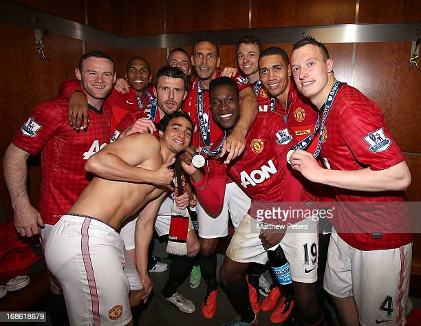 Wayne Rooney Michael Carrick Rafael da Silva Danny Welbeck Rio Ferdinand Chris Smalling and Phil Jones of Manchester United celebrates with the...