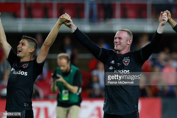 Wayne Rooney of DC United celebrates with his teammates after DC United defeated the Vancouver Whitecaps 31 during his MLS debut at Audi Field on...