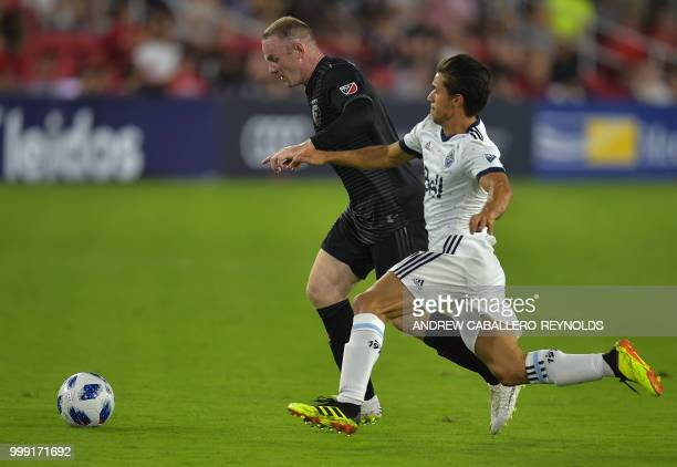 Wayne Rooney of DC United fights for the ball during the DC United vs the Vancouver Whitecaps FC match in Washington DC on July 14 2018