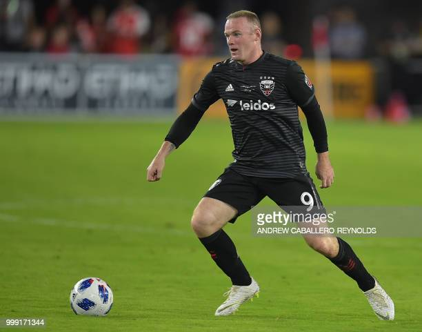 Wayne Rooney of DC United looks to pass during the DC United vs the Vancouver Whitecaps FC match in Washington DC on July 14 2018