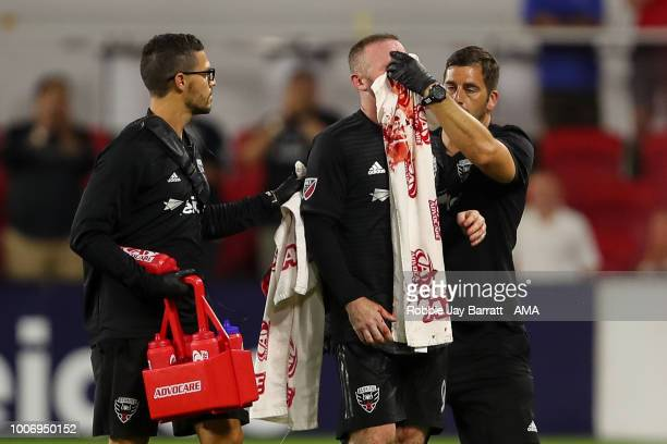 Wayne Rooney of DC United receives a bloody nose after a challenge with Axel Sjoberg of Colorado Rapids during the MLS match between DC United and...