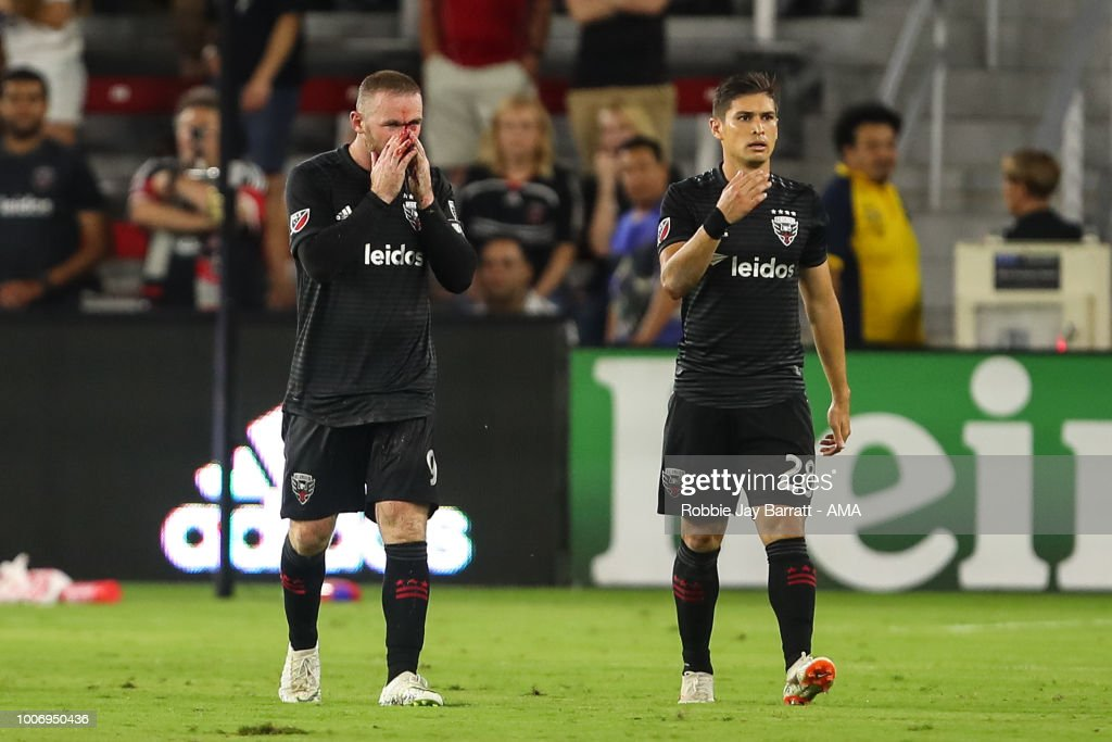 Wayne Rooney of DC United receives a bloody nose after a challenge with Axel Sjoberg of Colorado Rapids during the MLS match between DC United and Colorado Rapids at Audi Field on July 28, 2018 in Washington, DC.
