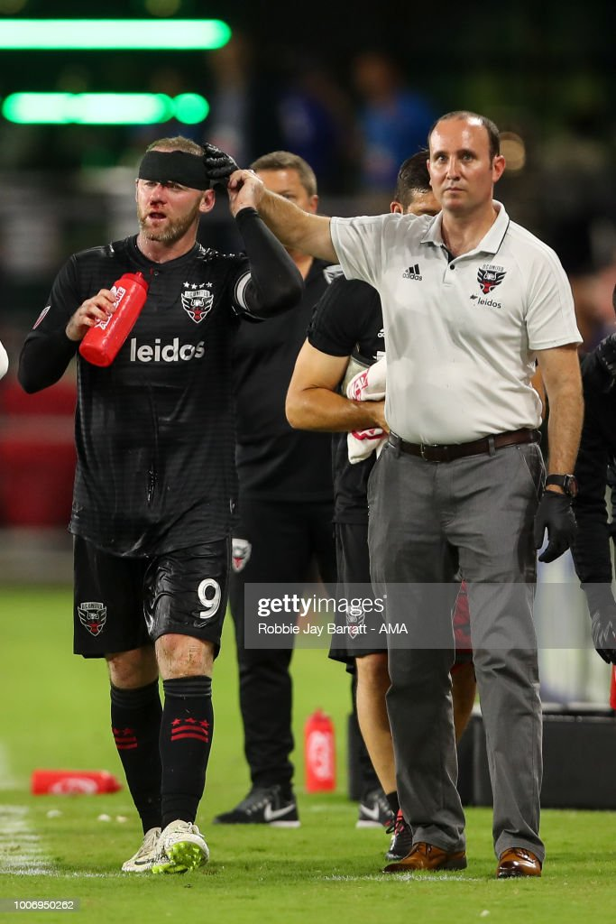 Wayne Rooney of DC United receives treatment for a bloody nose after a challenge with Axel Sjoberg of Colorado Rapids during the MLS match between DC United and Colorado Rapids at Audi Field on July 28, 2018 in Washington, DC.
