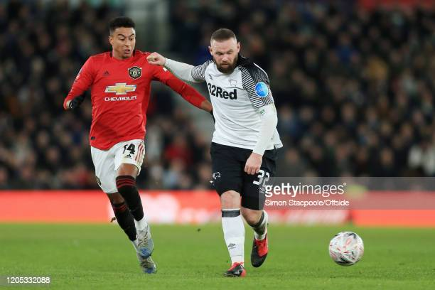 Wayne Rooney of Derby battles with Jesse Lingard of Man Utd during the FA Cup Fifth Round match between Derby County and Manchester United at Pride...
