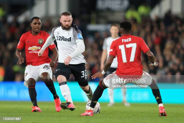 Wayne Rooney of Derby battles with Odion Ighalo of Man Utd and Fred of Man Utd during the FA Cup Fifth Round match between Derby County and...