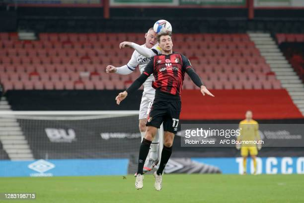 Wayne Rooney of Derby County and Jack Stacey of Bournemouth during the Sky Bet Championship match between AFC Bournemouth and Derby County at...