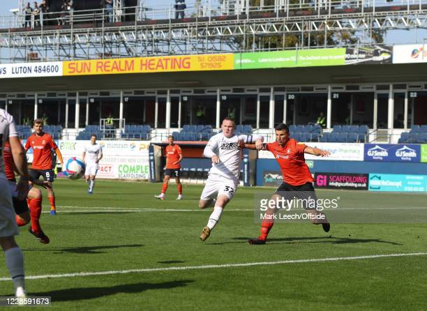 Wayne Rooney of Derby County and Matty Pearson of Luton Town in action at Kenilworth Road during the Sky Bet Championship match between Luton Town...