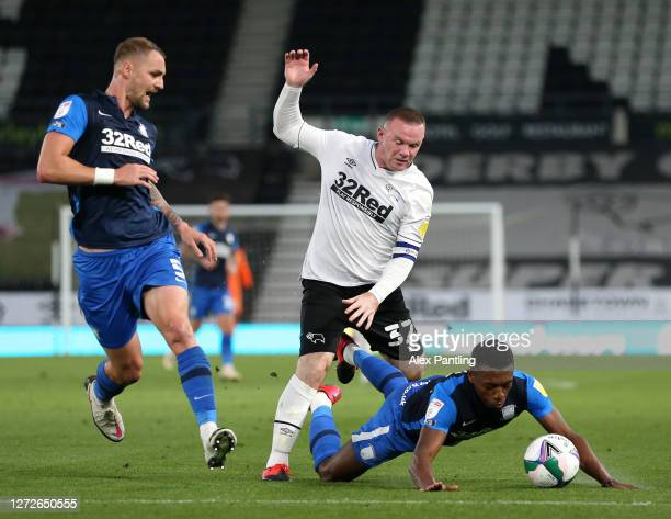 Wayne Rooney of Derby County battles for possession with Patrick Bauer and Darnell Fisher of Preston North End during the Carabao Cup Second Round...
