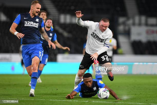 Wayne Rooney of Derby County fouls Darnell Fisher of Preston during the Carabao Cup match between Derby County and Preston North End at the Pride...
