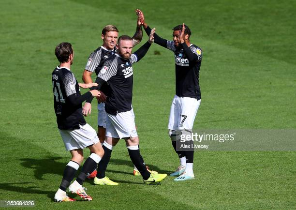 Wayne Rooney of Derby County is congratulated after he scores the opening goal during the Sky Bet Championship match between Preston North End and...