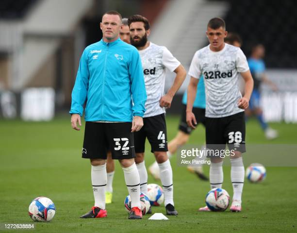 Wayne Rooney of Derby County looks on as he warms up prior to the Carabao Cup Second Round match between Derby County and Preston North End at Pride...