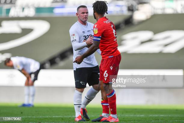 Wayne Rooney of Derby County shakes hands with Liam Moore of Reading after the final whistle during the Sky Bet Championship match between Derby...