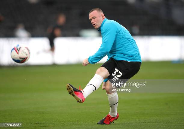 Wayne Rooney of Derby County shoots as he warms up prior to the Carabao Cup Second Round match between Derby County and Preston North End at Pride...