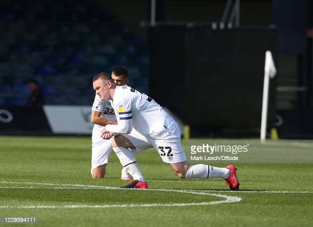 Wayne Rooney of Derby County takes a knee before the Sky Bet Championship match between Luton Town and Derby County at Kenilworth Road on September...