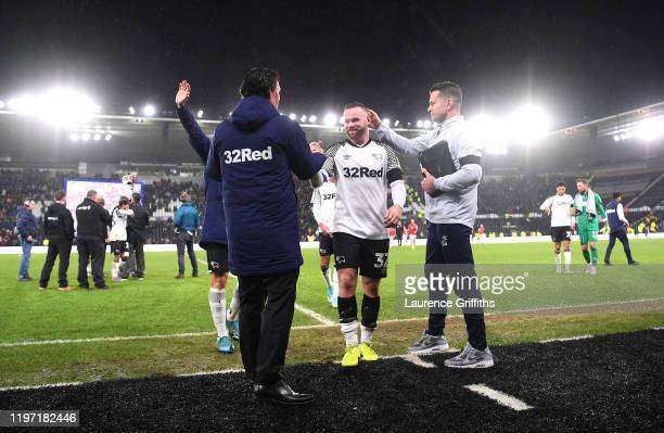 Wayne Rooney of Derby County walks off the pitch after making his debut as Shay Given, Head goalkeeping coach pats him on the back after the Sky Bet...