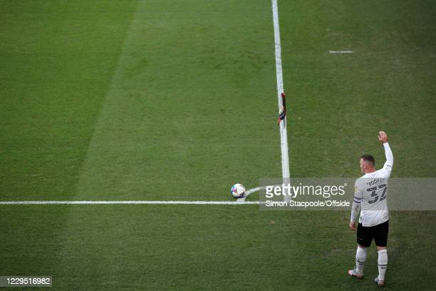 Wayne Rooney of Derby prepares to take a corner during the Sky Bet Championship match between Derby County and Barnsley at Pride Park Stadium on...