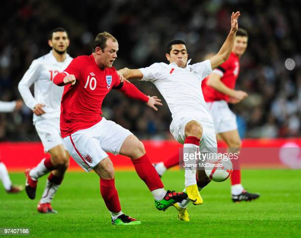 Wayne Rooney of England and Ahmed Fathi of Egypt battle for the ball during the International Friendly match between England and Egypt at Wembley...