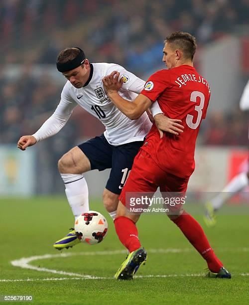 Wayne Rooney of England and Artur Jedrzejczyk of Poland