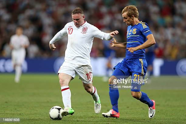 Wayne Rooney of England and Bohdan Butko of Ukraine fight for the ball during the UEFA EURO 2012 group D match between England and Ukraine at Donbass...