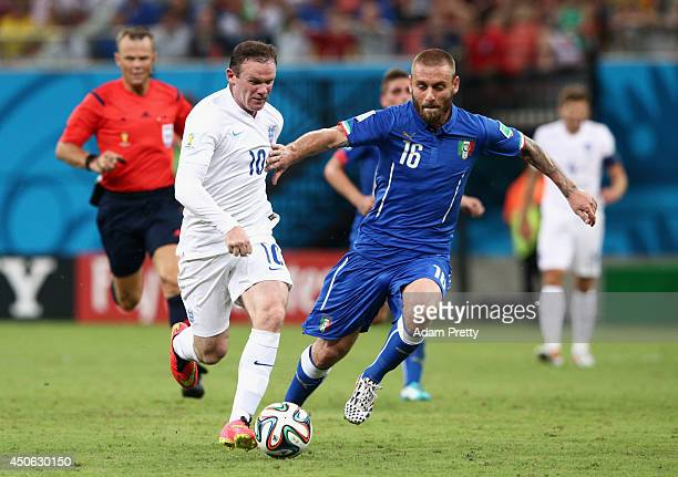 Wayne Rooney of England and Daniele De Rossi of Italy battle for the ball during the 2014 FIFA World Cup Brazil Group D match between England and...