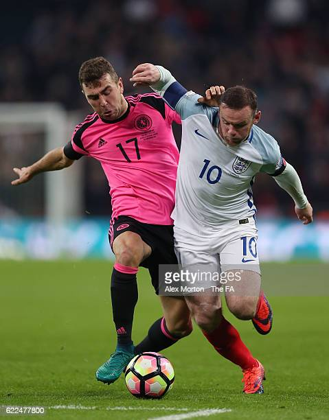 Wayne Rooney of England and James McArthur of Scotland compete for the ball during the FIFA 2018 World Cup Qualifier between England and Scotland at...