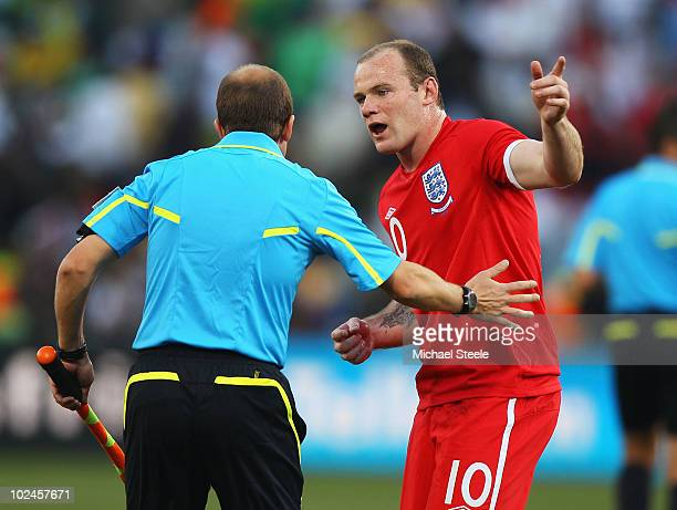 Wayne Rooney of England appeals to Linesman Mauricio Espinosa of Uruguay after he disallowed a goal by Frank Lampard of England during the 2010 FIFA...