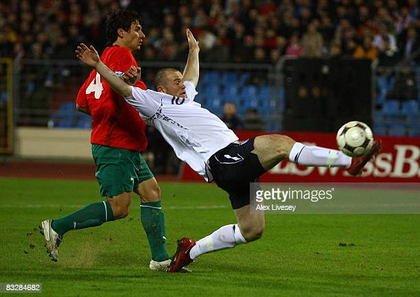 Wayne Rooney of England appears to be pulled back by Sergei Omelyanchuk of Belarus during the FIFA2010 World Cup Qualifying match between Belarus and...