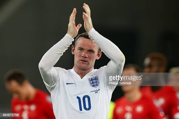 Wayne Rooney of England applauds the fans after the EURO 2016 Qualifier match between Switzerland and England on September 8 2014 in Basel Switzerland
