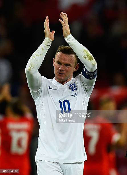 Wayne Rooney of England applauds the fans after the UEFA EURO 2016 Group E qualifying match between England and Switzerland at Wembley Stadium on...