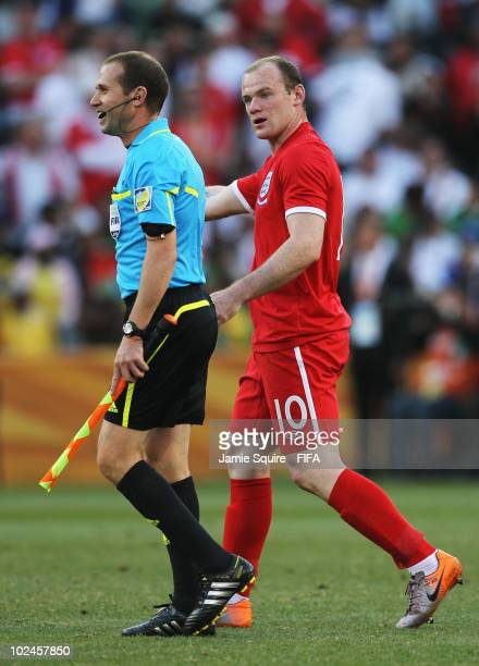 Wayne Rooney of England argues with the linesman as England have a goal disallowed during the 2010 FIFA World Cup South Africa Round of Sixteen match...