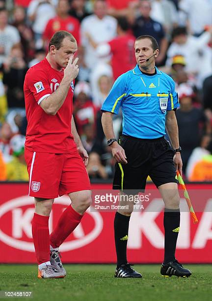 Wayne Rooney of England argues with the linesman Mauricio Espinosa as England are denied a goal decision during the 2010 FIFA World Cup South Africa...